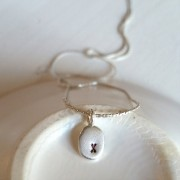 """Sterling Silver Oval Pendant Necklace With """"x"""""""